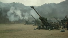 Howitzer Artillery - Simultaneous firings - stock footage