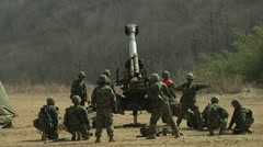 Howitzer Artillery Fire - wide shot. South Korean soldiers Stock Footage