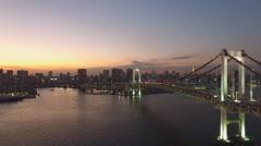 "Flying over the ""rainbow bridge"" across Tokyo Bay Stock Footage"