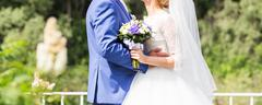Beautiful wedding bouquet in hands of the bride close-up Stock Photos