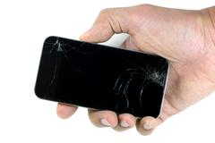 Right male hand holding a cracked smartphone isolated on white background - stock photo