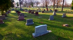 Flying low, like a spirit, over gravestones in cemetery Stock Footage