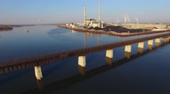 Flying with seagulls over beautiful old,rusty railroad train bridge - stock footage