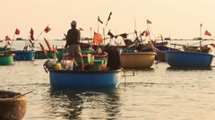 Closeup Round Vietnamese Fishing Boats Float on Sea Stock Footage