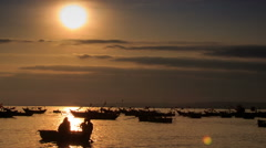 Fishing Boat Silhouette Rows in Sea Bay at Sunset in Vietnam Stock Footage