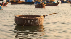 Empty Round Vietnamese Fishing Boat Floats on Sea Stock Footage