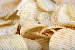 many of potato chips horizontal  texture - stock photo