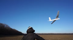 Happy Child Playing with an airplane on a meadow Stock Footage