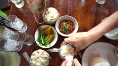 Point of view of hand eating variety traditional Thai food cuisine from top - stock footage