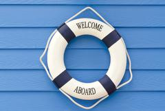Life buoy  welcome aboard sign Stock Photos
