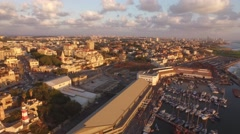 JAFFA, ISRAEL - Sweeping aerial of Old Yafo city & port and sunset in 4K Stock Footage