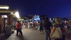 Disney Springs Orlando people walking at night Stock Footage