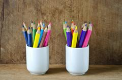 Color pencils in white cup - stock photo