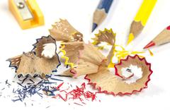 Pencil shavings and color pencils Stock Photos