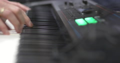 Music Producer Playing On Keyboard Stock Footage