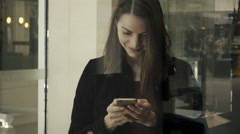 Pretty woman texting on her cellphone in the financial district Stock Footage