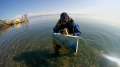 Underwater painter Yuriy Alekseevbrings brings to the picture Stock Footage