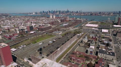 Slow Flyover View Of Jersey City & NYC Skyline In Background - stock footage
