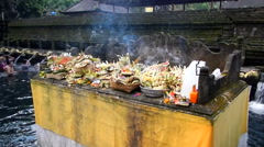 Smoking altar in Tirta Empul Temple,Bali - stock footage