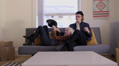 Couple Take A Break From Moving, Man Teases His Girlfriend, Plays With Her Hat Stock Footage