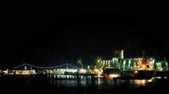 Tanker Docking Near City On Rainy Night Stock Footage