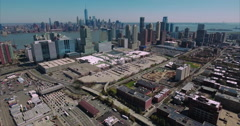 Stationary & Then Ascending View Of Jersey City and NYC Skyline In Background Stock Footage