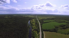 Aerial view over the river and road. sunny weather Stock Footage