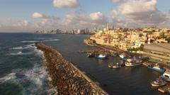 JAFFA, ISRAEL (4K) - Stunning aerial shot of Old Yafo port & Tel Aviv at sunset Stock Footage
