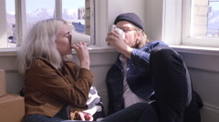 Couple Drink Coffee On The Floor Of Their New Apartment, They Cheers And Kiss - stock footage