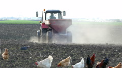 Tractor and fertilizer spreader on the field - stock footage