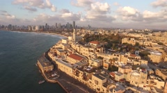 JAFFA, ISRAEL (4K) - tracking aerial shot of Old Yafo port & Tel Aviv at sunset Stock Footage