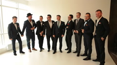 nine men in suits posing for the camera - stock footage