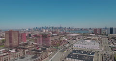 Fly Backwards Shot Of Hoboken and Jersey City, NYC Skyline In Background. Stock Footage