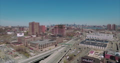 Ascending Shot Of Jersey City, NYC Skyline In BackGround. Stock Footage