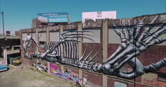 Hoboken and Jersey City Ascending Shot Of Graffiti Building & Freeway - stock footage