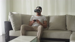 Man Wearing VR Headset and Playing Games with Controller at Living Room. Stock Footage