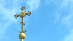 The cross on the dome of an orthodox temple against the sky with clouds Stock Footage