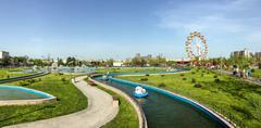 Panorama View Of People Having Fun In Amusement Park - stock photo