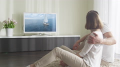Couple Watching Romantic Movie on TV at Living Room - stock footage