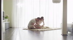 Couple Playing with Shiba Dog in Living Room. Stock Footage