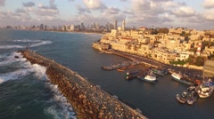 JAFFA, ISRAEL (4K) - aerial of Yafo port, Mediterranean, Tel Aviv at sunset Stock Footage