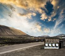road and restaurant advertisement casks near mountains - stock photo
