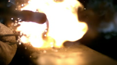 Slow motion of torch lighting with striker Stock Footage