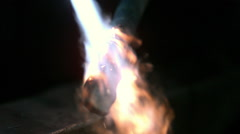 Slow motion of torch heating up piece of metal. Stock Footage