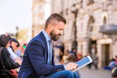Hipster manager with tablet, Piccadilly Circus, London - stock photo
