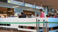 Passengers checking in at the security line at the Valencia, Spain Airport. Stock Footage