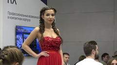 The model on display - brunette with braids - stock footage