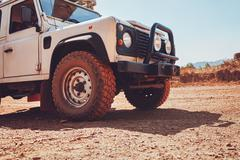 Off road vehicle on country road - stock photo