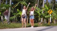 Hipster Hippie Girls Hitchhiking Vintage Retro Minibus on Road Stock Footage