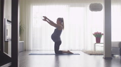 Young Pregnant Woman Doing Fitness in Living Room at Home. Stock Footage